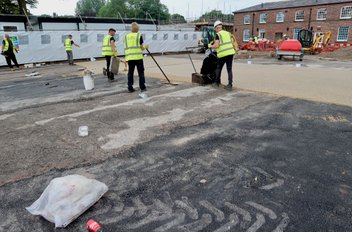during a resin bound car park paving