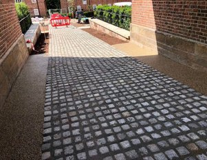 car park entrance foot path resin bound